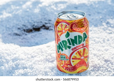 Lodz, Poland, January 28, 2017: Can of Mirinda soft drink. Created in Spain. Mirinda has been owned by PepsiCo since 1970, winter, snow
