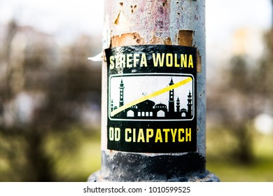 """Lodz, Poland, January 6, 2018 """"Free zone from Muslims"""", racist stickers in the park, lack of tolerance for followers of Muslim religions, crossed mosque"""