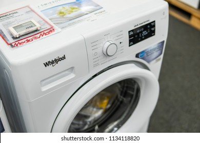Lodz, Poland, July 11, 2018 inside Media Markt electronic store, free-standing Whirlpool FWSG71283WPL washing machine on display, 7kg, 6thsense, Freshcare technology, produced by Whirlpool Co