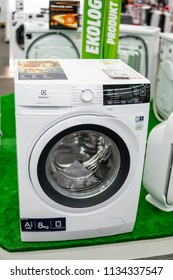 Lodz, Poland, July 11, 2018 inside Media Markt electronic store, free-standing Electrolux A+++ EW6F328WP PerfectCare 600 washing machine on display, 8kg, produced by Electrolux AB