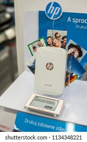 Lodz, Poland, July 11, 2018 inside Media Markt electronic store, HP Sprocket partable photo printer on display, Zink Photo Paper Snapshots, produced by Hewlett-Packard Company commonly known as HP