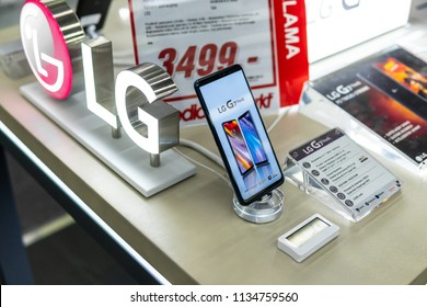 Lodz, Poland, July 11, 2018 inside Media Markt electronic store, LG G7 ThinQ smartphone on display, presentation on screen most important features of LG G7 ThinQ with Android system