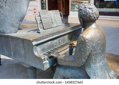LODZ, POLAND - JULY 19, 2019: Monument to Arthur Rubinstein (1887-1982), a Polish American classical pianist in Lodz, Poland.