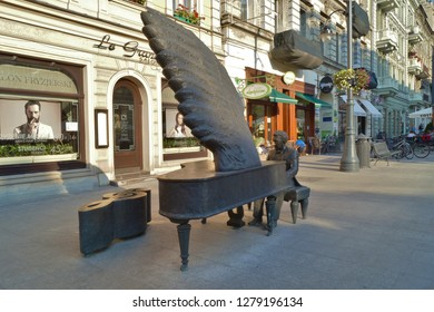 LODZ, POLAND - JULY, 2015: Piotrkowska street.Monument to Arthur Rubinstein (1887-1982), a Polish classical pianist in Lodz, Poland.