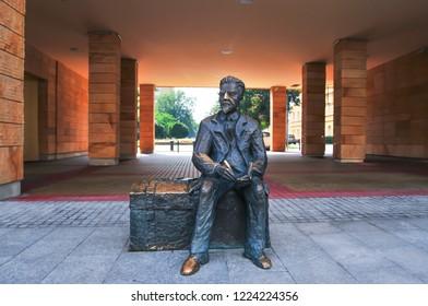 Lodz, Poland, July 2018. Monument of Wladyslaw Reymont (1867-1925) on Piotrkowska street, a Polish novelist and 1924 Nobel Prize laureate.