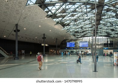 Lodz, Poland - July, 2019: Lodz Fabryczna railway station's new modern architecture and passengers there. Łódź Fabryczna is the largest and most modern railway station in Łódź, Poland
