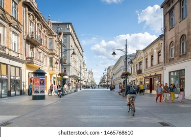Lodz, Poland - July 2019: People and view of Piotrkowska Street in Lodz city central area. Piotrkowska Street in Łódź, Poland, is one of the longest commercial street in Europe.