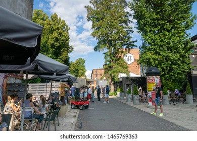 Lodz, Poland - July 2019: People and view of Lodz city central area.  Łódź is the third-largest city in Poland and a former industrial hub.