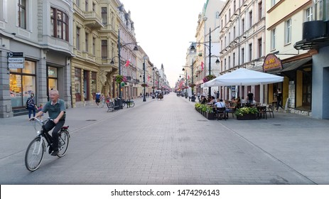 Lodz, Poland - July 2019: People and view of Piotrkowska Street in Lodz city central area. Piotrkowska Street in Łódź, Poland, is one of the longest commercial street in Europe