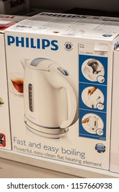 Lodz, Poland, July 22, 2018 inside RTV EURO AGD electronic store, box with Electric Water Kettle Philips HD4646 on display for sale, 1,7l capacity with water level display, produced by Philips