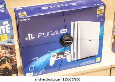 Lodz, Poland, July 28, 2018 inside RTV EURO AGD electronic store, box with Sony PlayStation 4 Pro PS4 on display for sale, PlayStation 4 PS4 is game console from Sony