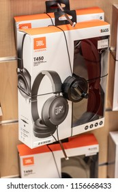 Lodz, Poland, July 28, 2018 inside RTV EURO AGD electronic store, JBL by Harman On-Ear Earphones T450 Headset with High-definition Audio on display for sale, headphones produced by JBL