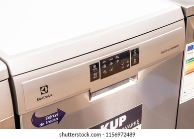 Lodz, Poland, July 28, 2018 inside RTV EURO AGD electronic store, free-standing silver Inox dishwasher Electrolux ESF8560ROX on display for sale, front panel, produced by Electrolux, selective focus