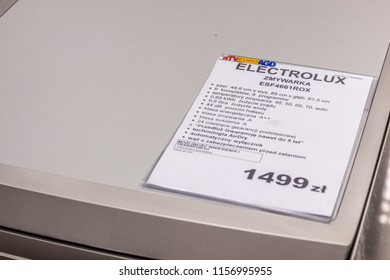 Lodz, Poland, July 28, 2018 inside RTV EURO AGD electronic store, free-standing silver Inox dishwasher Electrolux ESF4661ROX on display for sale, front panel, produced by Electrolux, selective focus