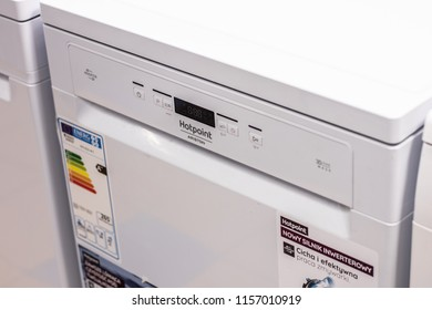 Lodz, Poland, July 28, 2018 inside RTV EURO AGD electronic store, free-standing white dishwasher Hotpoint-Ariston HFO3C21WC on display for sale, front panel, produced by Hotpoint-Ariston