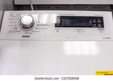 Lodz, Poland, July 28, 2018 inside RTV EURO AGD electronic store, free-standing Electrolux Top Loading Washing Machine EWT11367VIW with Energ label A+++ on display, produced by Electrolux,
