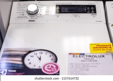 Lodz, Poland, July 28, 2018 inside RTV EURO AGD electronic store, free-standing Electrolux Top Loading Washing Machine EWT11367VIW with Energ label A+++ on display, produced by Electrolux