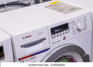 Lodz, Poland, July 28, 2018 inside RTV EURO AGD electronic store, free-standing Bosch WLG2426KPL Serie4 SlimLine FamilyLine washing machine on display VarioPerfect A+++ BSH Home Appliances