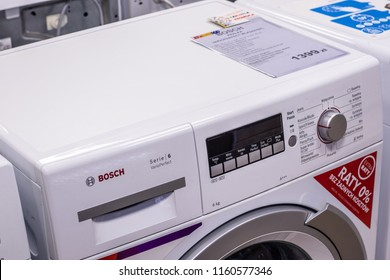 Lodz, Poland, July 28, 2018 inside RTV EURO AGD electronic store, free-standing Bosch WLK2427EPL Serie6 SlimLine washing machine on display Eco VarioPerfect EcoSilence Drive AquaStop A+++ BSH Home App