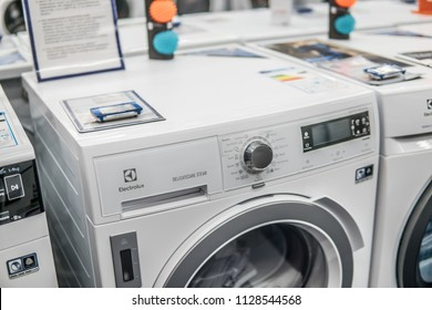 Lodz, Poland, July 5, 2018 inside Saturn electronic store, free-standing Electrolux dryer washing machine on display, produced by Electrolux AB Swedish multinational home appliance manufacturer