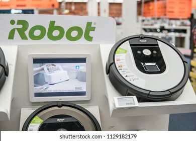 Lodz, Poland, July 6, 2018 inside Saturn electronic store, iRobot Roomba vacuum cleaner robots powerful cleaning system with intelligent sensors to clean Pet hair, crumbs, dirt, and daily dust