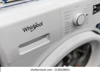 Lodz, Poland, July 9, 2018 inside Saturn electronic store, free-standing Whirlpool washing machine on display, produced by Whirlpool Corporation American multinational manufacturer of home appliances