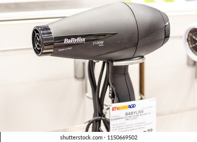 Lodz, Poland, July 9, 2018 inside RTV EURO AGD electronic store, BaByliss Paris 2100W ionic Made in Italy Hair dryer on display for sale, produced by BaByliss