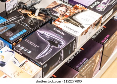 Lodz, Poland, July 9, 2018 inside RTV EURO AGD electronic store, boxes with Grundig, Philips, BaByliss Hair dryers on display for sale