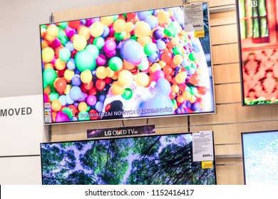 Lodz, Poland, July 9, 2018 inside RTV EURO AGD electronic store, LG LED and OLED 4K HDR 65inch 65SJ800V ultra HD on display for sale, UHD Smart TV produced by LG