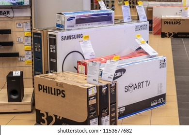 Lodz, Poland, July 9, 2018 inside RTV EURO AGD electronic store, boxes with Samsung, Philips LED, OLED 4K ultra HD TVs on display for sale