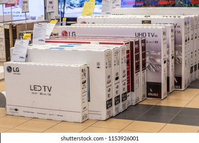 Lodz, Poland, July 9, 2018 inside RTV EURO AGD electronic store, boxes with Philips, Sony, LG, Thomson, Samsung, Hitachi, Panasonic LED, OLED 4K ultra HD TVs on display for sale