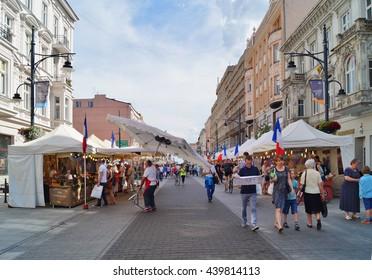 LODZ, POLAND, JUNE 19 2016 : Piotrkowska Street in Lodz . Main shopping street. Sunday afternoon on Piotrkowska Street.French market,