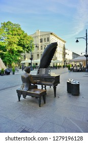 LODZ, POLAND - JUNE 22, 2016: Piotrkowska street.Monument to Arthur Rubinstein (1887-1982), a Polish classical pianist in Lodz, Poland.