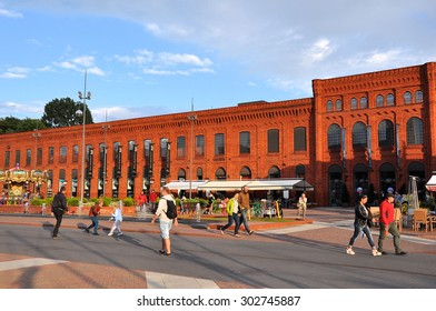 LODZ, POLAND - JUNE 23: People visiting Manufaktura shopping mall and leisure complex on June 23, 2015 in Lodz, Poland. It's a former spinning mill building of Izrael Poznanski factory, Poland.