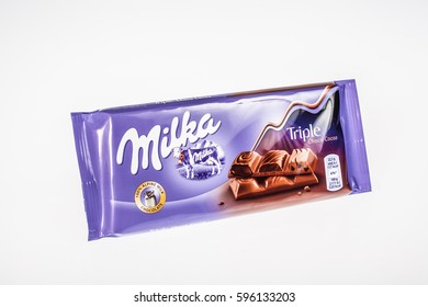 Lodz, Poland, March 07, 2017: A bar of Milka Mondelez Alpenmilch milk chocolate with the purple cow