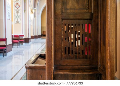 Lodz, Poland - March 30, 2015: Wooden window of confessional box at church