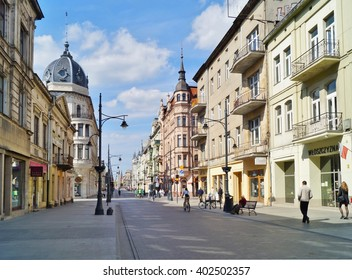 LODZ, POLAND - MAY 03, 2015: Piotrkowska Street in Lodz . Main shopping street. Sunday afternoon on Piotrkowska Street