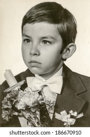LODZ, POLAND, MAY 14, 1978: Vintage photo of boy at his First Communion