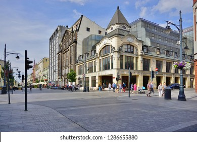 LODZ, POLAND - MAY 2017: Piotrkowska Street in Lodz . Main shopping street. Sunday afternoon on Piotrkowska Street