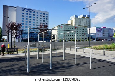 LODZ, POLAND, MAY, 30 2018: Avenue of Marshal Józef Pilsudski in Lodz. Architecture in the center of lodz. Hotels and office buildings and street workout