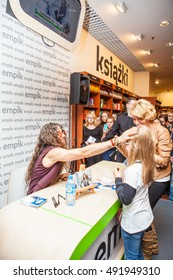 Lodz, Poland, October 01, 2016: Manufaktura Fashion Week, special guest, Michal Szpak, giving autographs to his fans. Polish singer performing music from the borderland of pop and rock.