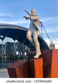 LODZ, POLAND - September 17, 2018 : A scupture in front of the entrance to the newly rebuilt Lodz Fabryczna railway station -it is the largest and most modern station in the city.