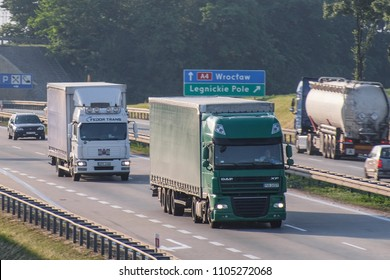 Lodz region, Poland - May, 31, 2018: traffic on a highway in Poland  with trucks on a frontground