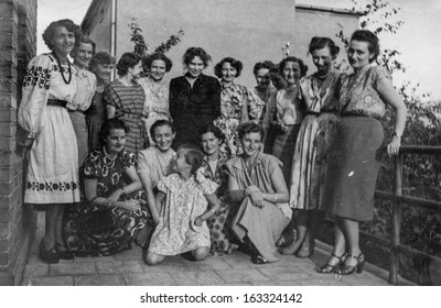 LODZ,POLAND, CIRCA FORTIES -  vintage photo of group of unidentified women and a little girl posing on balcony - circa forties
