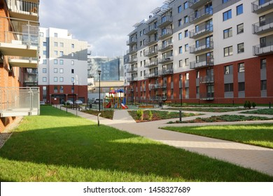 "LODZ.POLAND JULY 11 2019: New modern housing estate""ŁAKOWA"". Architecture of the city of Lodz, Poland .A colorful playground in a block of flats"