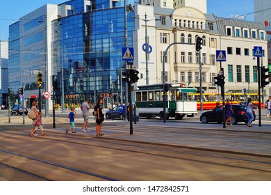 LODZ,POLAND, JUNE,28,2019; Center of Lodz. Architecture in the center of lodz. Offices, hotels, banks and shopping centers.Pedestrian crossing