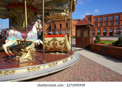 LODZ,POLAND MAY 25 2017:  Children's carousel -Inner square of Manufaktura, an arts centre, shopping mall, and leisure complex in Lodz, Poland