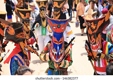 LOEI PROVINCE,THAILAND- JUNE 11:Unidentified men wear ghost costumes at Ghost Festival (Phi Ta Khon - a masked procession celebrated by Buddhist) at Dan Sai district in Loei Province on June 11, 2013.
