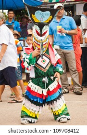 LOEI PROVINCE,THAILAND-JULY 23:Unidentified boy wears ghost costumes at Ghost Festival (Phi Ta Khon - a masked procession celebrated by Buddhist) at Dan Sai district in Loei Province on July 23, 2012.