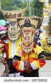 LOEI PROVINCE,THAILAND-JUNE 23:Unidentified men wear ghost costumes at Ghost Festival (Phi Ta Khon- a masked procession celebrated by Buddhist)  Dan Sai district in Loei Province on June 23, 2012.